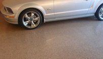 Garage floor with Polyaspartic Coating application.